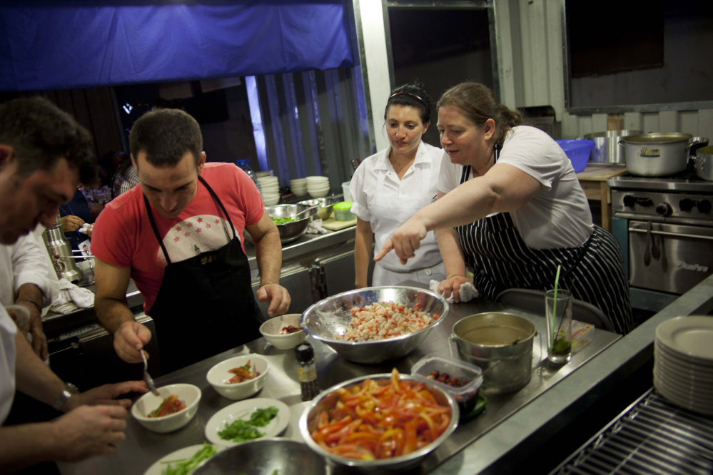 Sara Jenkins, right, spends time at a kitchen in Cuba in 2012.