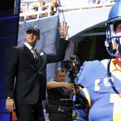 California's Jared Goff waves as after being selected by the Los Angeles Rams as first pick in the  2016 NFL football draft on Thursday in Chicago.
