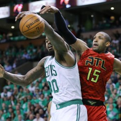 Atlanta center Al Horford knocks a rebound away from Celtics forward Amir Johnson in the first half of Game 6 Thursday night in Boston.