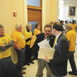 Advocates of a bill that aims to increase solar energy generation in Maine gather at the State House in Augusta on Friday morning as lawmakers considered Gov. Paul LePage's veto of that and dozens more bills.