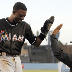 Miami Marlins' Dee Gordon, left, gets congratulations from manager Don Mattingly after scoring Wednesday. Gordon says he unknowingly took the performance-enhancing drugs that led to his 80-game suspension, but he'll accept the penalty.