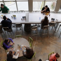 University of New Hampshire students have lunch at a $17,570 custom-made chef's table, shown at top, in a campus dining hall on Friday in Durham, N.H.