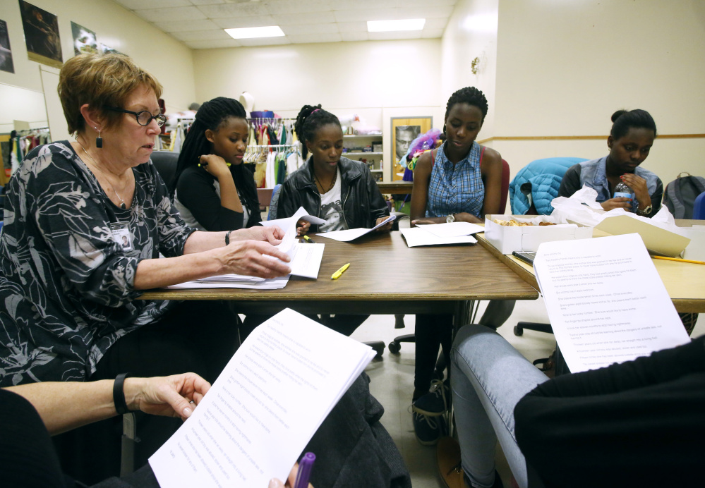 """Drama teacher Kathleen Harris rehearses with Deering students for """"It Could Happen to You."""" From left are Grace Uwimana, Kennie Maero Mdayshimye, Dorcas Uwase and Gracia Ruganza."""