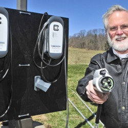 Scott Cowger, co-owner of the Maple Hill Farm Inn and Conference Center, demonstrates a newly installed electric car charger at his business in Hallowell.