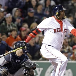 Red Sox designated hitter David Ortiz watches a two-run homer in front of New York Yankees catcher Brian McCann during the eighth inning of Friday night's game at Fenway Park.