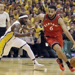 Cory Joseph of the Toronto Raptors goes to the basket against Ty Lawson of the Indiana Pacers during the first half of Indiana's 101-83 victory Friday night in Game 6 of their playoff series.