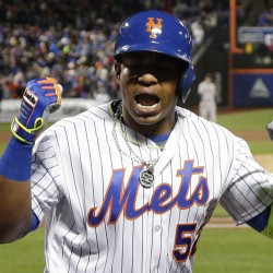 Yoenis Cespedes of the Mets reacts after his grand slam against the Giants during New York's 12-run third inning Friday night in New York. Cespedes drove in six runs in the inning.