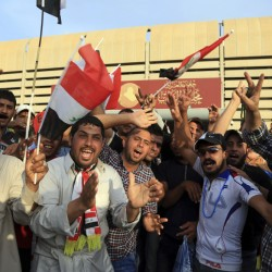 Supporters of Shiite cleric Muqtada al-Sadr raise the Iraqi flags outside parliament in Baghdad's Green Zone, Saturday.