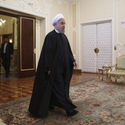 The Associated Press In this April 17, 2016 file photo, Iranian President Hassan Rouhani arrives for a meeting with Indian Foreign Minister Sushma Swaraj at the presidency office in Tehran, Iran. Iranian state TV says that the moderate-reformist bloc has secured more than 20 more seats in parliamentary runoff elections, bringing the bloc closer to a majority in the next legislature.