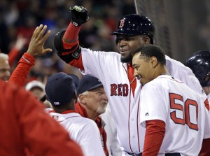 The Associated Press Boston Red Sox designated hitter David Ortiz gets a high-five at the dugout as he and Mookie Betts, right, celebrate Ortiz's two-run homer against the New York Yankees in the eighth inning at Fenway Park on Friday. The Red Sox won 4-2.