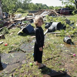 Memphis Melton, 7, looks at the destruction in his aunt's backyard in Lindale, Texas Saturday.