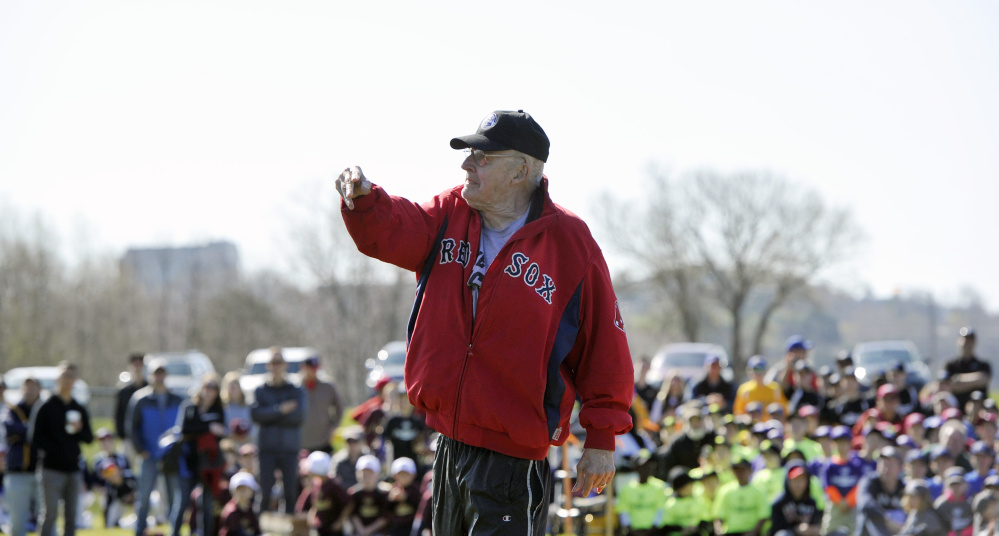 Longtime Little League coach Ron Farr, 78, throws out the opening pitch during Little League Opening Day ceremonies on Saturday. Farr has been coaching little league in Portland for 54 years.