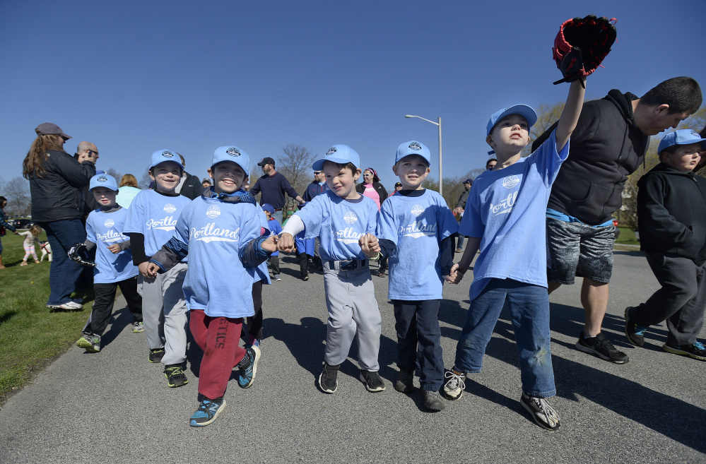 Little Leaguers from the Poland Spring team march in the parade during Opening Day Ceremonies at Payson Park in Portland on Saturday. Portland Little League has 62 teams competing with 680 participants.