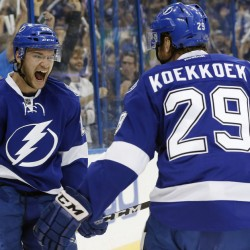 Tampa Bay left wing Jonathan Drouin, left, celebrates with defenseman Slater Koekkoek after Drouin's goal gave the Lightning a two-goal lead in the first period of their 4-1 win over the New York Islanders on Saturday in Tampa, Florida.