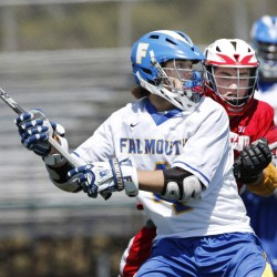 Falmouth's George Gilbert winds up for a shot while being defended by Jack Tierney of South Portland. Gilbert scored on the play – one of his five goals in Falmouth's 21-10 victory.