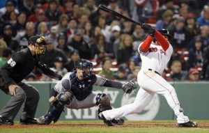 Boston outfielder Jackie Bradley Jr. follows through on a two-run triple in front of the Yankees' Brian McCann during the seventh inning in Boston Saturday. (AP Photos/Michael Dwyer)