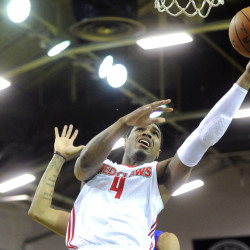PORTLAND, ME - FEBRUARY 24: Maine Red Claws take on Delaware 87ers at the Expo on Thursday, February 25, 2016. Coty Clarke of Maine lays the ball up after driving past Christian Wood and Earl Clark, right of Delaware. (Photo by Derek Davis/Staff Photographer)