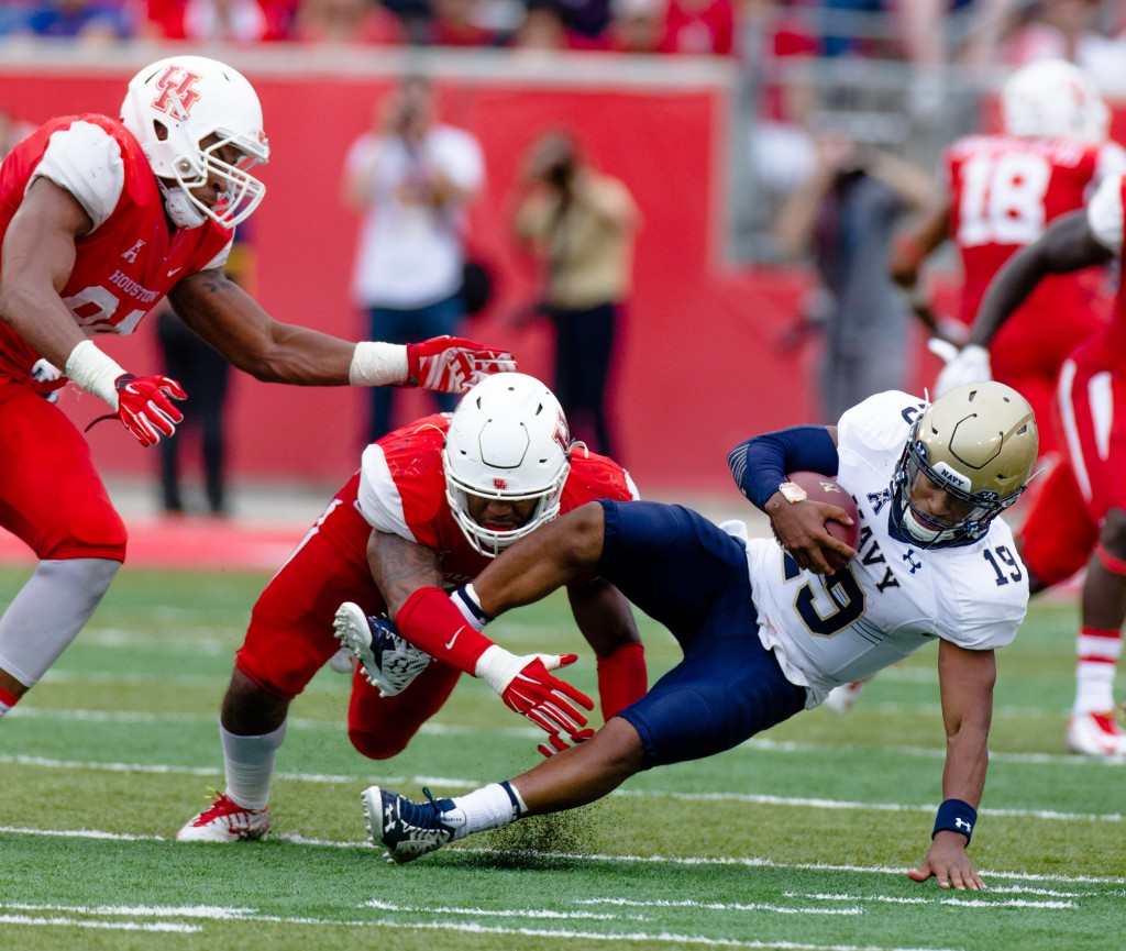 6TH ROUND (214): Houston linebacker Elandon Roberts sacks Navy's quarterback Keenan Reynolds in a November game. The Associated Press