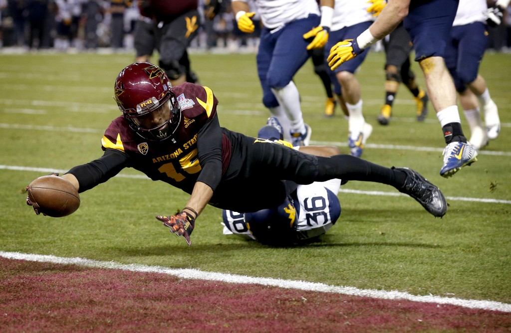 7TH ROUND (225): Arizona State wide receiver Devin Lucien scores a touchdown against West Virginia in the Cactus Bowl in January. The Associated Press