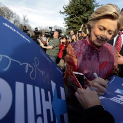Hillary Clinton signs autographs after voting Tuesday at the Grafflin Elementary School in Chappaqua, N.Y.