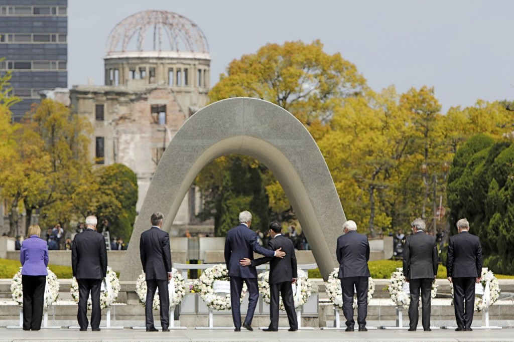 U.S. Secretary of State John Kerry puts his arm around Japan's Foreign Minister Fumio Kishida after they and fellow G7 foreign ministers laid wreaths at the cenotaph at Hiroshima Peace Memorial Park and Museum in Hiroshima, Japan. Reuters