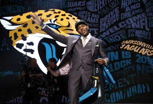 Florida State's Jalen Ramsey poses for photos after being selected by Jacksonville Jaguars as the fifth pick in the first round of the 2016 NFL  draft. The Associated Press