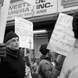 Daniel Berrigan marches with about 40 others outside of the Riverside Research Center in New York on April 9, 1982, calling for peace and a reduction in nuclear arms. Berrigan was among 15 protesters arrested after crossing police lines and throwing lamb's blood at the officers. The pacifist priest has died at 94.