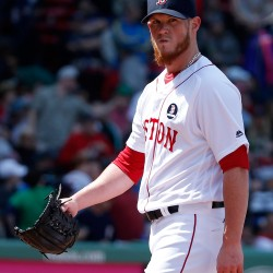 Craig Kimbrel reacts as he returns to the dugout after giving up three runs during the eighth inning.