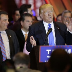 Donald Trump speaks at a news conference Tuesday night in New York as New Jersey Gov. Chris Christie listens at left. Trump won all five states that held primaries Tuesday. The Associated Press