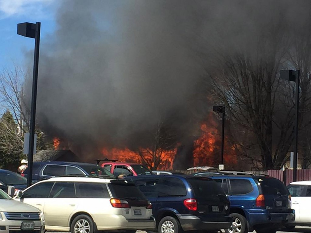 Flames show from a fire in Gray's business district Thursday.