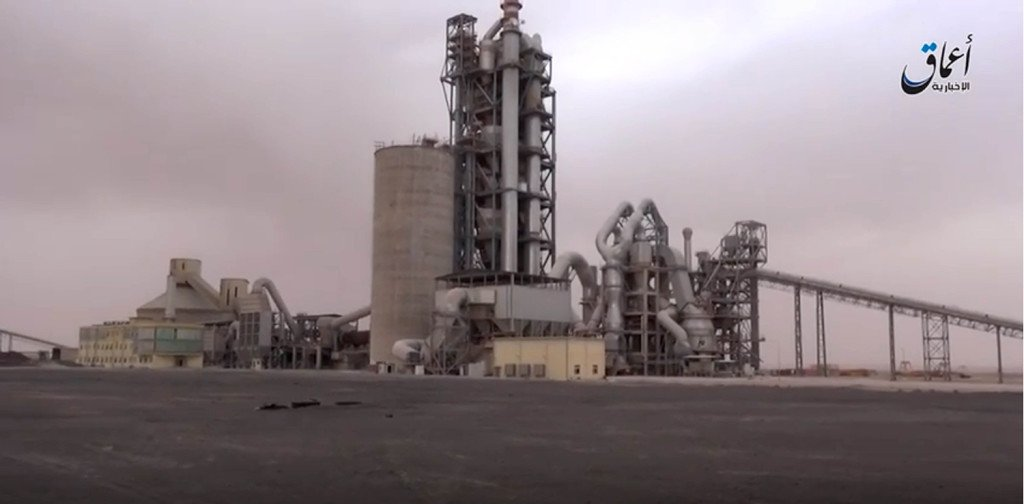 This image made from video published online by Amaq News Agency of the Islamic State group shows a cement factory where in a brazen assault near the Syrian capital, Islamic State militants snatched up to 300 cement workers and contractors from their workplace northeast of Damascus Thursday. The Associated Press