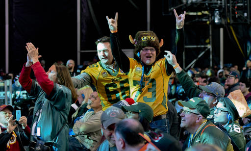 North Dakota fans celebrate after Carson Wentz is selected by the Philadelphia Eagles as the number 2 pick in the first round of the 2016 NFL  draft. The Associated Press