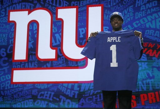 Ohio State's Eli Apple poses for photos after being selected by New York Giants as the 10th pick in the first round of the 2016 NFL draft. The Associated Press