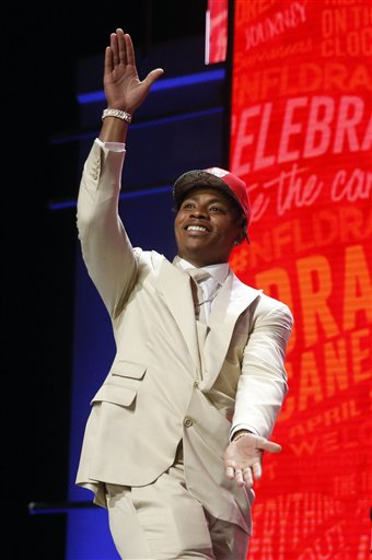 Florida's Vernon Hargreaves III walks on the stage after being selected by the Tampa Bay Buccaneers as the 11th pick in the first round of the 2016 NFL draft,. The Associated Press