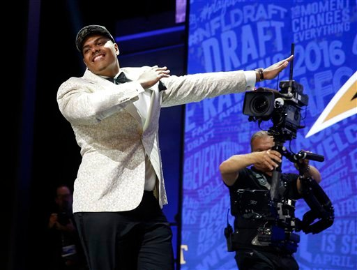 Notre Dame's Ronnie Stanley celebrates after being selected by Baltimore Ravens as the sixth pick in the first round of the 2016 NFL  draft. The Associated Press