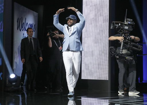 Ohio State's Ezekiel Elliott poses after being selected by the Dallas Cowboys as the fourth pick in the first round of the 2016 NFL  draft. The Associated Press