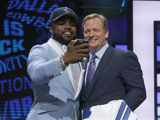 Ohio State's Ezekiel Elliott takes a selfie with NFL Commissioner Roger Goodell after being selected by Dallas Cowboys as the fourth pick in the first round of the 2016 NFL  draft. The Associated Press