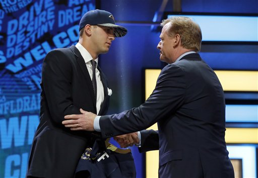 California's Jared Goff shakes hands with NFL Commissioner Roger Goodell after being selected by the Los Angeles Rams as the first pick in the first round of the  NFL draft Thursday in Chicago. The Associated Press