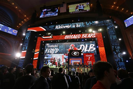 Georgia's Leonard Floyd images are display on the stage as he is selected by the Chicago Bears as the ninth pick in the first round of the 2016 NFL draft. The Associated Press