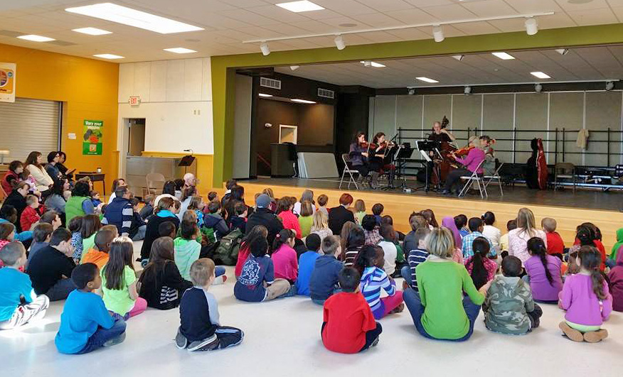 Students at Portland's Reiche Schoo watch a performance by musicians from the Portland Symphony Orchestra in this Culture Club event. PSO photo