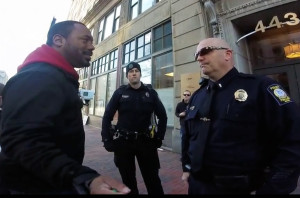 Pastor Andrew March speaks with police Lt. William Preis in front of Planned Parenthood in Portland.