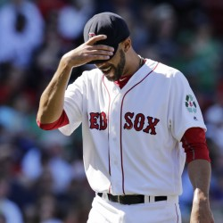 Boston Red Sox starting pitcher David Price tugs down on the brim of his cap while walking to the dugout after being pulled during the fourth inning of Thursday's game against the Tampa Bay Rays in Boston. The Associated Press