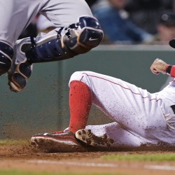 Tampa Bay catcher Curt Casali makes a bases-loaded force out at home as Boston's Chris Young slides toward the plate in the third inning Tuesday night.   The Associated Press