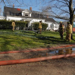 Firefighters clean up after fighting a fire on Grammar Road in Sanford on Wednesday morning.