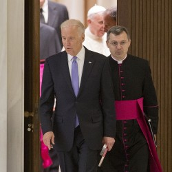 US Vice President Joe Biden enters the Pope Paul VI hall at the Vatican, to take part at  a congress on the progress of regenerative medicine and its cultural impact.