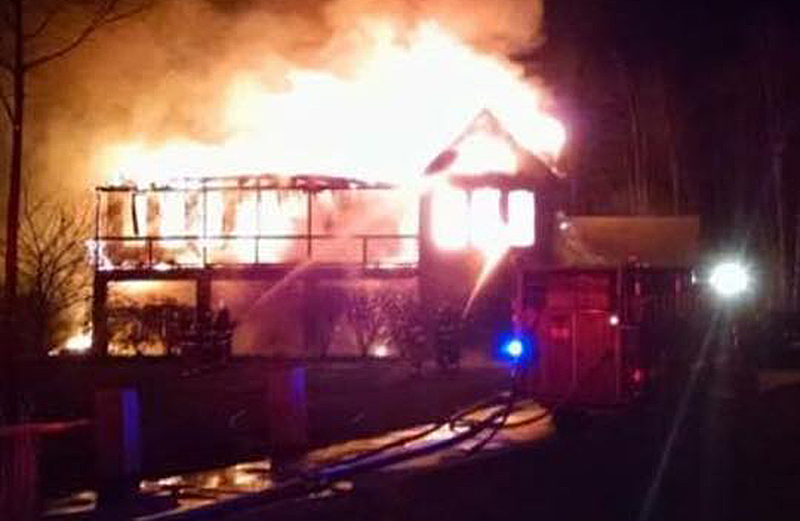 Fire engulfs a home on Rabbit Road in Sabattus. There were no fire hydrants in the area and there was little access to water. Photo from Sabattus Fire Department's Facebook page.