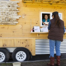 A customer is served at the SaltBox Cafe, parked on Eastern Promenade. Carl D. Walsh/Staff Photographer