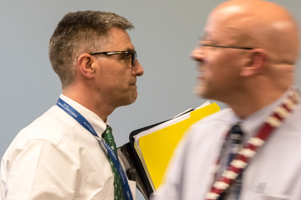SAD 6 Superintendent Frank Sherburne walks past school board member Daniel Kasprzyk on Tuesday before entering the board's executive session.