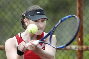 Scarborough's Megan Nathanson returns a shot during her 6-0, 6-0 win in the No. 1 singles match Monday against Gorham. Scarborough won a clash of unbeaten teams, 4-1, to end the regular season with a 12-0 record.  Joel Page/Staff Photographer