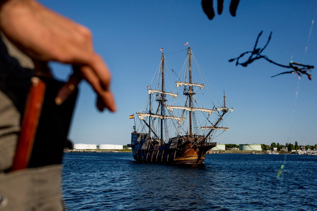 The tall ship El Galeon is framed by two fishermen trying to get snagged seaweed off their line at the end of the Maine State Pier as the Spanish vessel makes its way to the Maine Wharf on Tuesday.